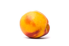 One beautiful juicy nectarine Stock Photos