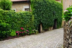 One of the beautiful narrow streets in Santillana del Mar, Cantabria, Spain. There is an old saying that Santillana del Mar is The Town of Three Lies, since it royalty free stock photo