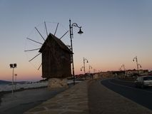 Sunset mill at old town Nessebar,Bulgaria royalty free stock images