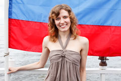 One beautiful woman unde Rusian flag Royalty Free Stock Image