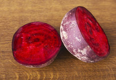 One beetroot divided into two. Stock Images