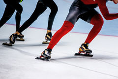 One behind other men athletes skaters Royalty Free Stock Photo