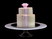 One beige cake with a pink rose Royalty Free Stock Images