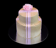 One beige cake with a pink rose Royalty Free Stock Image