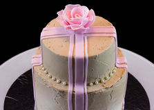 One beige cake with a pink rose Stock Photo