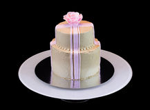 One beige cake with a pink rose Stock Photography