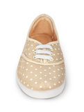 One beige women's sneakers with polka dots. Isolated on white background Royalty Free Stock Photo