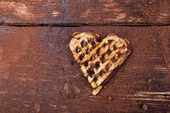 One belgian heart shaped waffle with chocolate on wooden background. Flat lay. Copy space Stock Photography