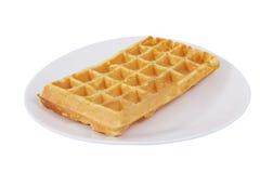 One Belgian waffle on plate, isolated on white background. Stock Photo