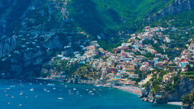 One of the best resorts of Italy with old colorful villas on the steep slope, nice beach, numerous yachts and boats in. Harbor and medieval towers along the royalty free stock photography