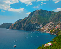 One of the best resorts of Italy with old colorful villas on the steep slope, nice beach, numerous yachts and boats in. Harbor and medieval towers along the stock photography