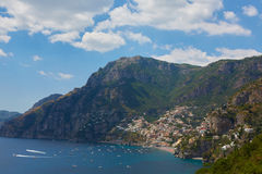 One of the best resorts of Italy with old colorful villas on the steep slope, nice beach, numerous yachts and boats in. Harbor and medieval towers along the stock image