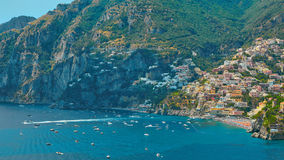 One of the best resorts of Italy with old colorful villas on the steep slope, nice beach, numerous yachts and boats in. Harbor and medieval towers along the royalty free stock image