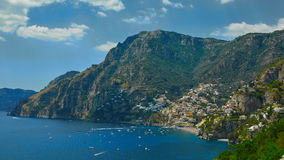 One of the best resorts of Italy with old colorful villas on the steep slope, nice beach, numerous yachts and boats in. Harbor and medieval towers along the royalty free stock photos