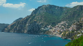 One of the best resorts of Italy with old colorful villas on the steep slope, nice beach, numerous yachts and boats in. Harbor and medieval towers along the royalty free stock images