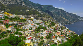 One of the best resorts of Italy with old colorful villas on the steep slope, nice beach, numerous yachts and boats in. Harbor and medieval towers along the stock photos