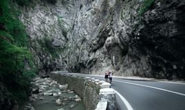 One of the best road in the world. Men walking on road stock photos