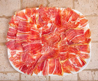 Plate of Spanish jamon iberico sliced Royalty Free Stock Photo