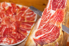 Slicing Spanish jamon iberico Royalty Free Stock Images