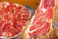 Slicing Spanish jamon iberico Royalty Free Stock Images