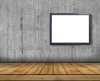 One big blank billboard attached to a concrete wall inside with wooden floor Stock Photos