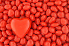One Big Candy Heart on Top of Small Valentine Candies Stock Photography