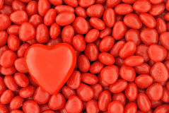 One Big Candy Heart on Top of Small Valentine Candies Royalty Free Stock Photography