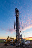 One Big Drill. Construction large drill standing tall with a dawn sky Stock Image