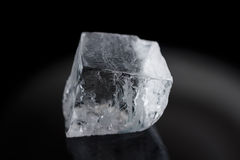 One big ice cube isolated on black Royalty Free Stock Images
