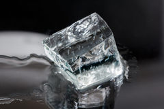 One big ice cube isolated on black Stock Images