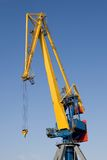 One big industrial crane. Single huge crane with blue sky at the background Royalty Free Stock Photo