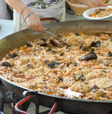 One big paella. Typical spanish paella for a hundred persons Stock Photography