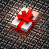 One big present box between smaller with flare Royalty Free Stock Images