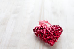 One big red heart on the background of wooden boards, Valentine`s day, the holiday of love Stock Images