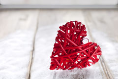 One big red heart on the background of wooden boards, Valentine`s day, the holiday of love.  Stock Image