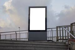 One big vertical / portrait orientation blank billboard in city. Street royalty free stock photography