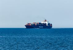 Cargo vessel on her way to Hamburg close to Cuxhaven royalty free stock image