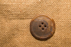 One big vintage button on  old cloth Stock Photo