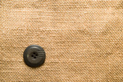 One big vintage button on  old cloth Royalty Free Stock Photography