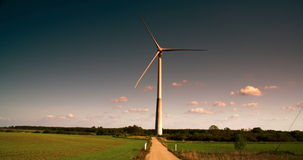 One big windmill on a field 4K FS700 Odyssey 7Q Stock Photography