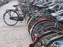 One bike out of place on the rack. A bike rack in Brussels Europe Stock Photo