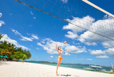 One bikini girl playing volleyball on white beach Royalty Free Stock Photo