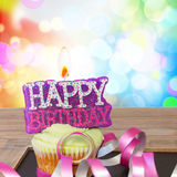 One birthday cupcake with happy birthday candle Stock Photos