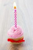 One birthday cupcake on table Royalty Free Stock Photography