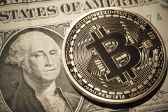 One Bitcoin on dollar banknote. Royalty Free Stock Photos