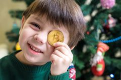 One Bitcoin in the hand of young boy. Concept. Crypto digital gold.  royalty free stock photography