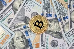 One bitcoin with hundred dollars. Bills Royalty Free Stock Image