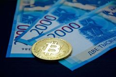 One bitcoin on new Russian 2000 rubles banknotes