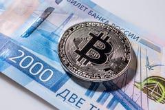 One Bitcoin on Russian banknotes. Closeup, macro shot. Banknote stock photography