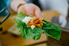 One Bite of Bulgogi. Eat Grilled Meat with Vegetable and Kimchi. Royalty Free Stock Photos